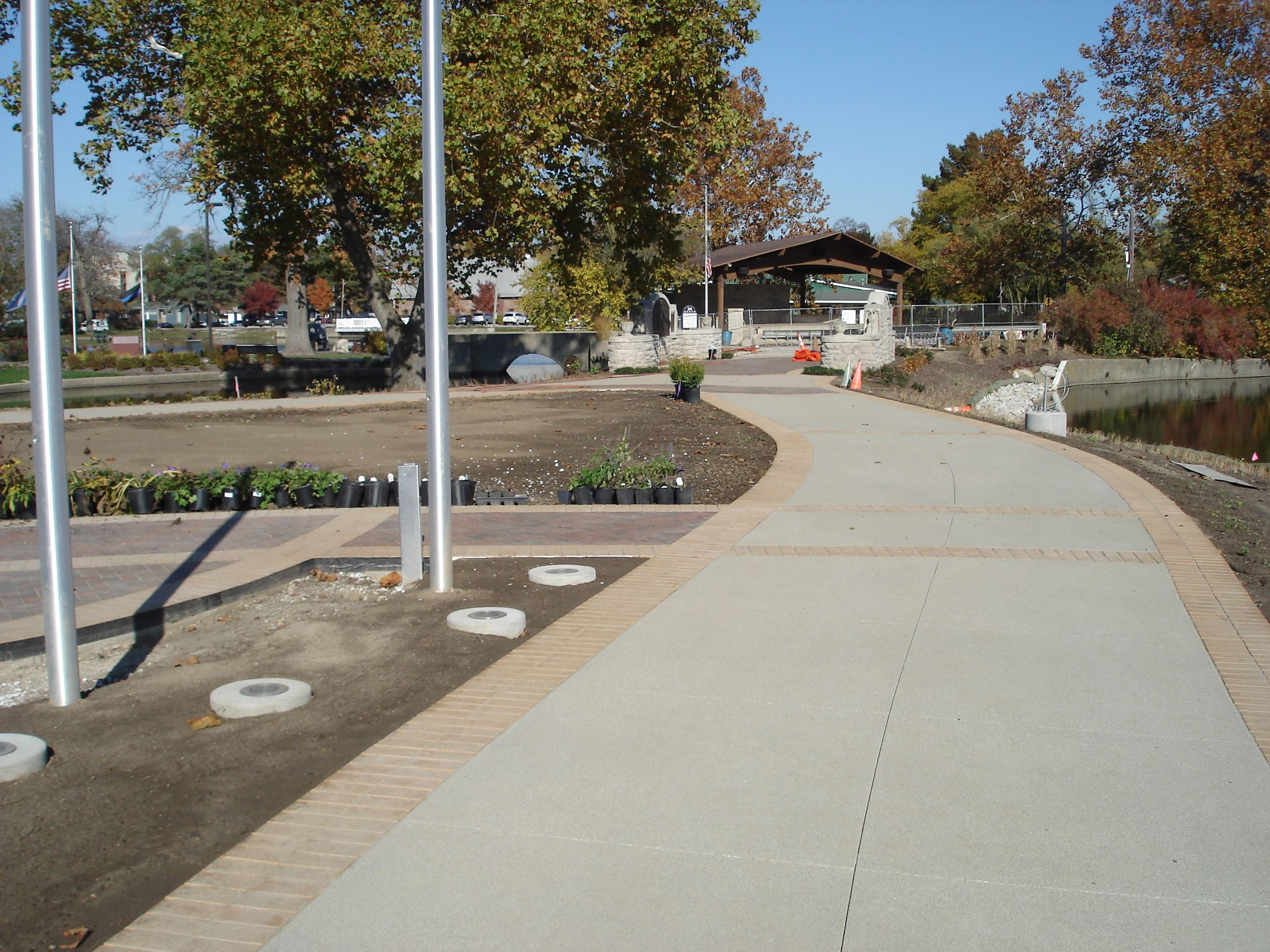 New sidewalk and pavers around Memorial Island