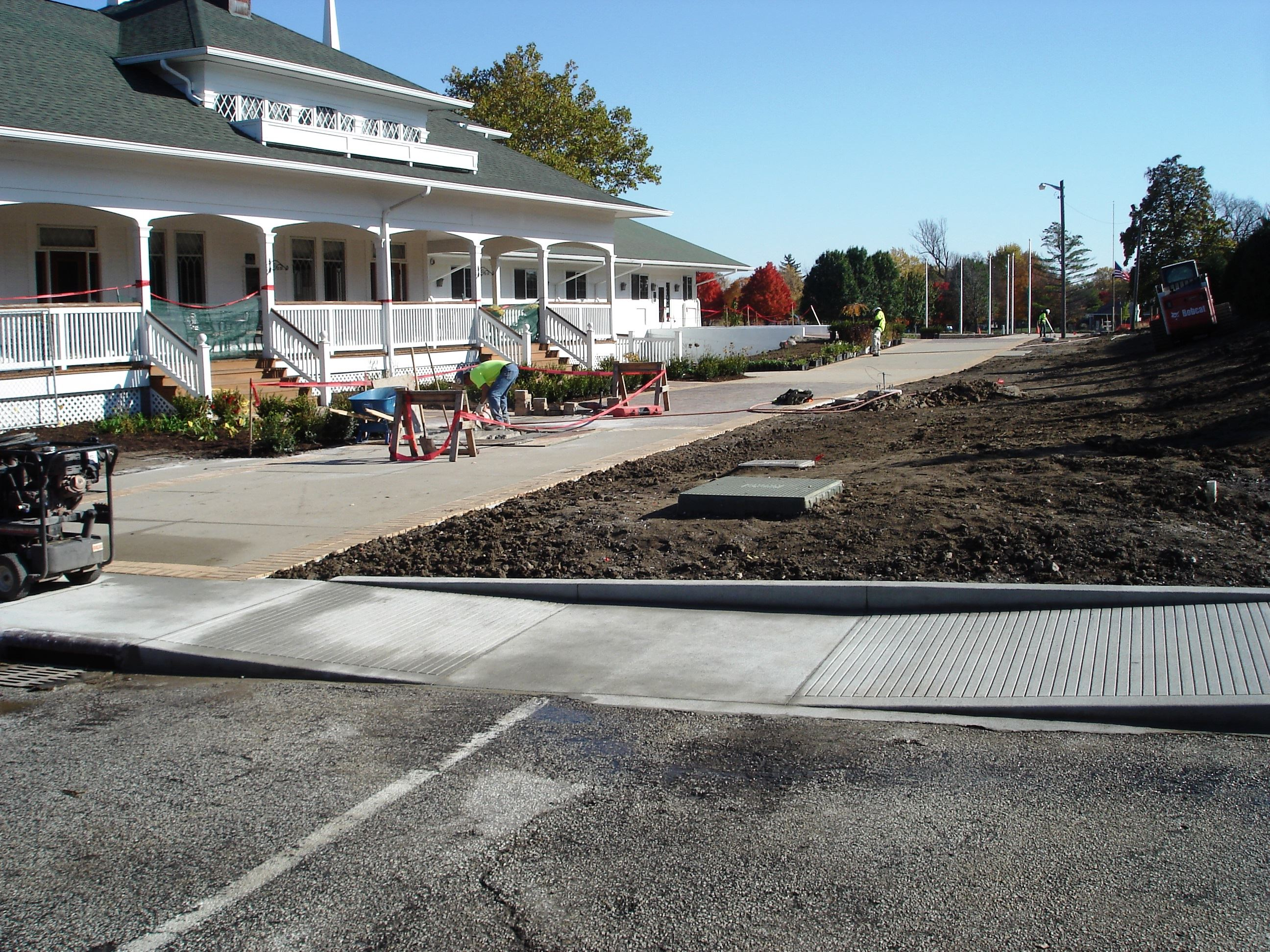 New sidewalks and ramp leading to Memorial Island