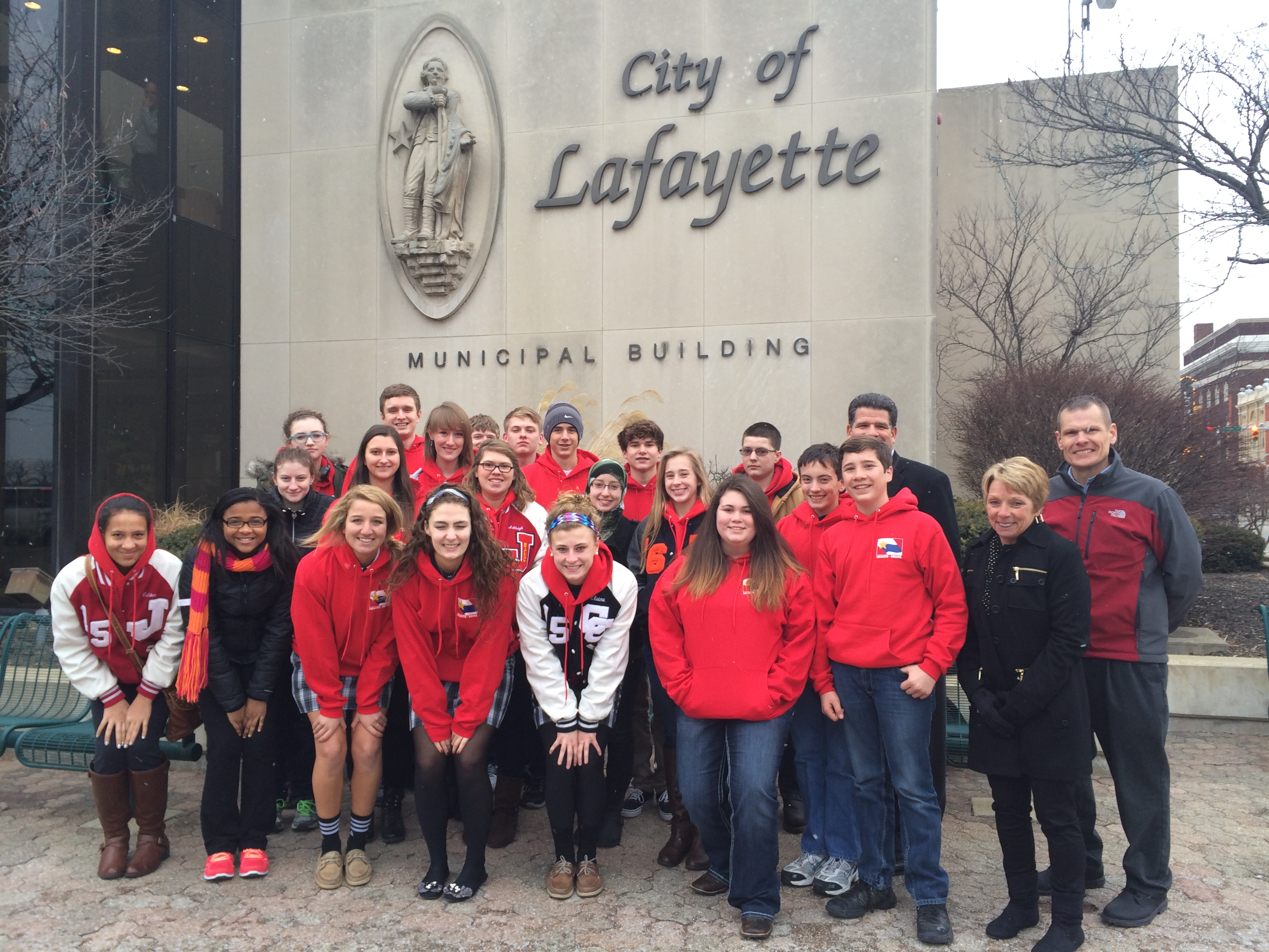 A group of teenagers standing in fron of the City of Lafayette sign